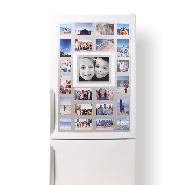 A mix of different photo frame sizes on a fridge