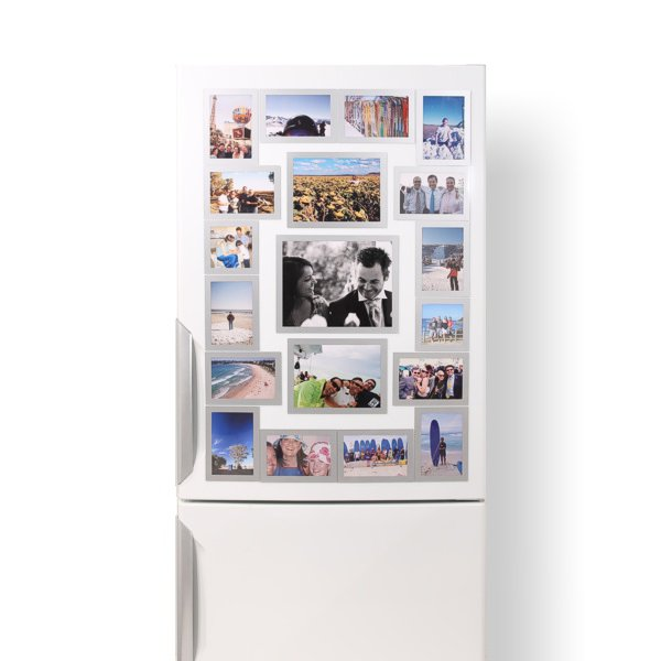 A mix of silver photo frame sizes on a fridge