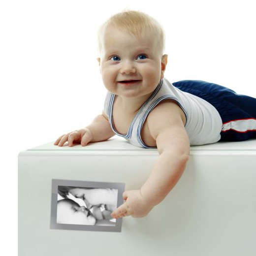 Baby on a Fridge point to their favorite photo in magnetic picture frame of them with their mother
