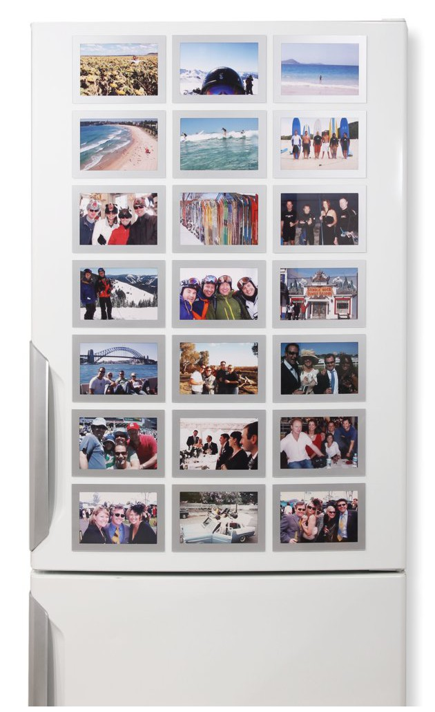 A refrigerator covered in Silver Fridgi Magnetic Picture Frames