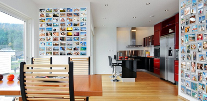 Two photo walls showing lots of family photos in the kitchen living area of a modern home